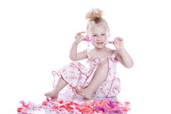 Small smiling baby in pink dress Stock Photography
