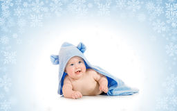 Small smiling baby with on snowy background Royalty Free Stock Photos