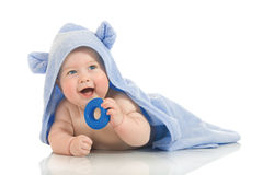 Small smiling baby with a towel stock photos