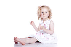 Small smiling baby in white dress Royalty Free Stock Photo