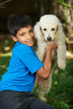 Small smiling boy with poodle dog Stock Images