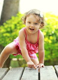 Small smiling child girl climbing Stock Photo