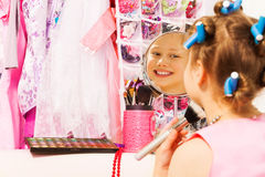 Small smiling girl with hair-curlers, face brush Stock Photography