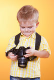 Small smiling photographer watch photo on camera Stock Images