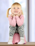 Small  smily girl sits  on a potty Royalty Free Stock Images
