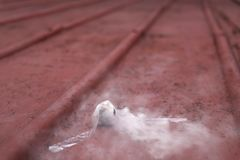 The small smoke bombs with white smoke. A small bomb with smoke Stock Photos