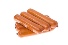 Small smoked sausages on white background. royalty free stock photos