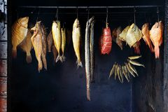 Small smokehouse. Marine fish from smokehouse is a great source of omega 3 and healthy life Royalty Free Stock Photo