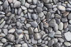 Small and smooth waterworn black pebble Royalty Free Stock Photos