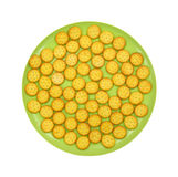 Small snack crackers on a green plate Royalty Free Stock Photos