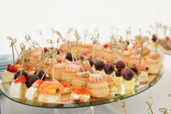 Small snacks in plate on table Stock Image