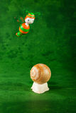 Small snail and bee, green background Royalty Free Stock Photography