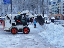 Small snow cleaning machine removes snow from the square at the ski resort. Snow removal at ski resort Rosa Khutor, Russia Royalty Free Stock Images
