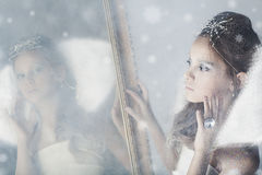 Small snow queen. 8 years old girl is like snow queen Royalty Free Stock Photos