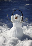 Small snowman with headphone Stock Images