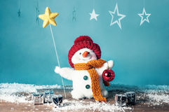 Small snowman with star and gifts Stock Image