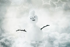 Small snowman in winter snow Stock Image