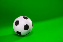 Small soccer ball over green background Stock Photos