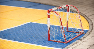 Small soccer field with football goal on children playground yar. Small soccer field with mini football goal on the children playground yard outdoor Royalty Free Stock Image