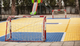 Small soccer field with football goal on children playground yar Royalty Free Stock Image