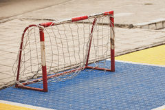 Small soccer field with football goal on children playground yar. Small soccer field with mini football goal on the children playground yard outdoor Royalty Free Stock Photo