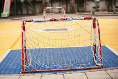 Small soccer field with football goal on children playground yar. Small soccer field with mini football goal on the children playground yard outdoor Royalty Free Stock Images