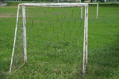 Small soccer football goalie. On green grass field Royalty Free Stock Image