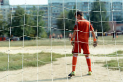 Small soccer goalkeeper. Photo of the young goalkeeper to play soccer rear view Stock Photography