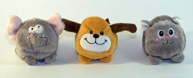 Small soft children`s toys depicting elephant cubs, dogs and cats. The picture was taken in close-up. stock photo