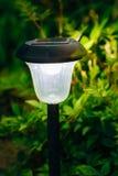 Small Solar Garden Light, Lantern In Flower Bed. Garden Design. Stock Image