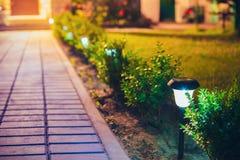 Small Solar Garden Light, Lantern In Flower Bed. Garden Design. Decorative Small Solar Garden Light, Lanterns In Flower Bed In Green Foliage. Garden Design Royalty Free Stock Image