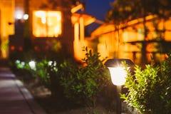 Small Solar Garden Light, Lantern In Flower Bed. Garden Design. Stock Photos