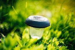 Small Solar Garden Light, Lantern In Flower Bed Stock Image