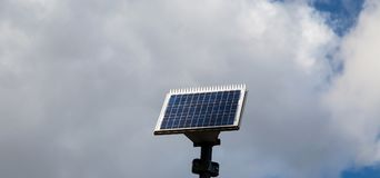Solar panel in with cloud background royalty free stock image