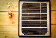 Small solar panel and a light bulb Royalty Free Stock Photo