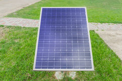 Small Solar panels on lawn. Close up small Solar panels on lawn Stock Photo