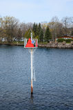 A small solar power sign on St Lawrence river Stock Photos