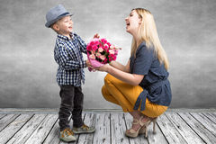 Small son gives his beloved mother a beautiful bouquet of pink roses . Spring, concept of family vacation. Women`s day,mother`s da. Spring, concept of family royalty free stock images