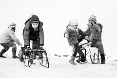Small southern romanian village. Scenes from a moody winter with children playing with sledges and enjoying the snow Royalty Free Stock Photo