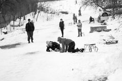 Small southern romanian village. Scenes from a moody winter with children playing with sledges and enjoying the snow Stock Image