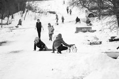Small southern romanian village. Scenes from a moody winter with children playing with sledges and enjoying the snow Royalty Free Stock Image