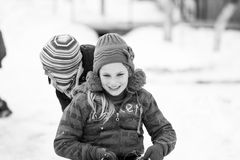 Small southern romanian village. Scenes from a moody winter with children playing with sledges and enjoying the snow Stock Photo