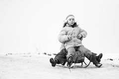 Small southern romanian village. Scenes from a moody winter with children playing with sledges and enjoying the snow Stock Photos