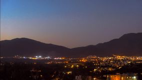A small southern town in the mountains, the transition from day to night. Aerial video timelapse stock video footage