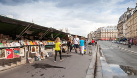 Small souvenir shops with walking people, Paris, France Stock Images