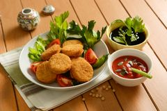 Free Small Soy Burger With Soy Sauce And Tomato Sauce And Sunflower S Stock Photography - 110490392