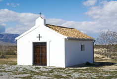 Small Spanish church. In the Andalusian countryside, with mountains in the background Royalty Free Stock Photography
