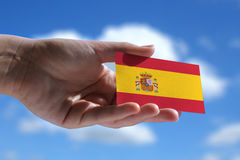 Small Spanish flag against sky Royalty Free Stock Images