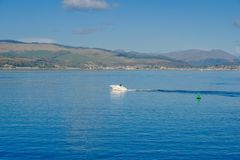 Small Speed Boat on the River Clyde in October Sunshine stock photography
