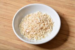 Minced onion. Small spice dish of dried minced onion flakes Royalty Free Stock Images